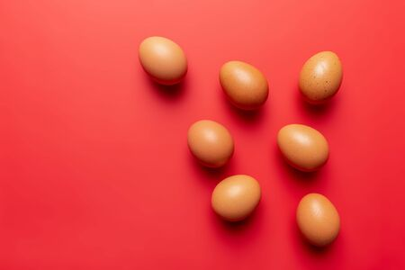 brown eggs texture on colored red background full frame Stok Fotoğraf