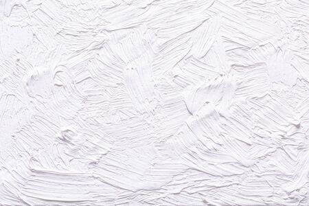 Abstract white grunge painted background. Background was painted with titinium white oil color on canvas by hand.