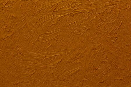 Abstract painted background. Background was painted with ochre brown oil color on canvas by hand.