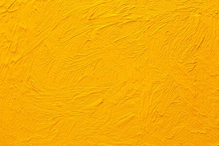 Abstract painted background. Background was painted with yellow orange oil color on canvas by hand. Zdjęcie Seryjne