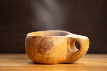 Wooden handmade cup with hot cocoa