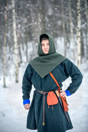 Young man in medieval European costume, historical reenactment