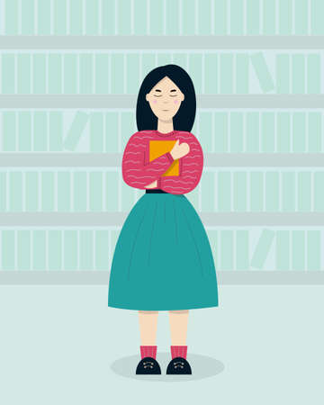 A girl stands and clutches a book in a bookstore.