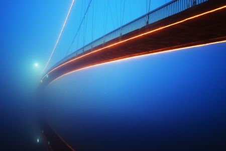 bridge over water: Bridge in a foggy night Stock Photo