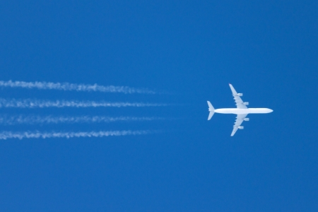 Jumbo jet in clear sky photo