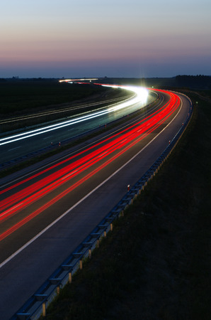 Dense traffic on a highway at night