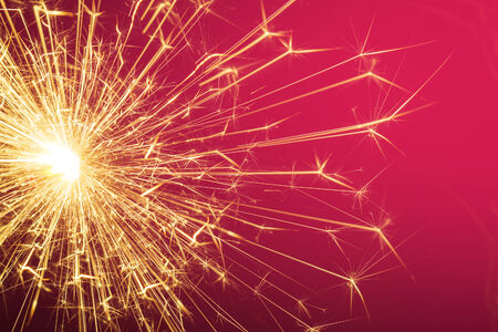 Sparkler with pink background  Stock Photo