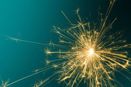 Sparkler with green background