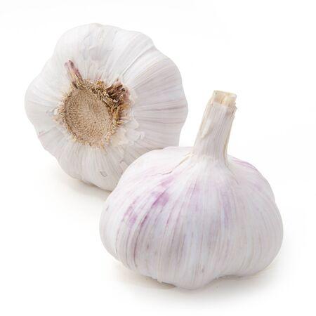 closeup shot two garlic on white