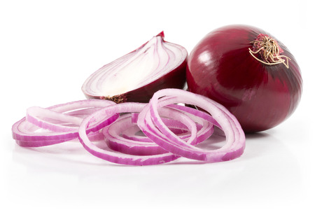 red onion with onion rings on white bachground