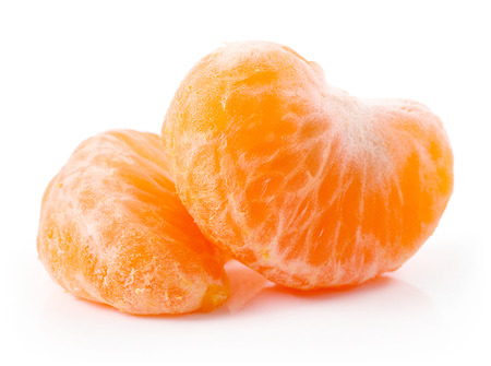 Slice of tangerine isolated on white