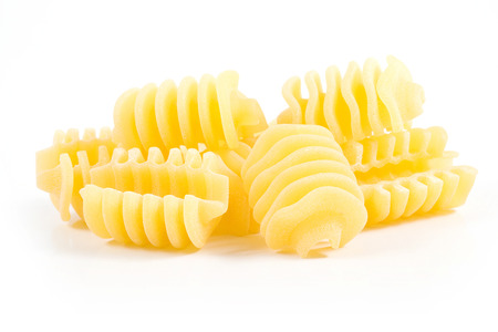 isolated italian pasta radiatore on white