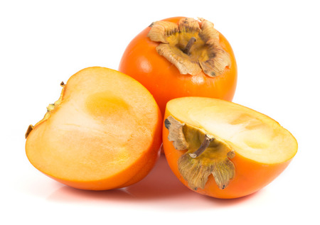 Orange ripe persimmon isolated over white  Stok Fotoğraf