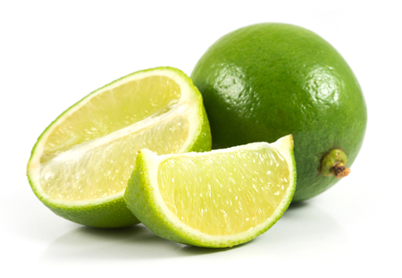 Fresh sliced limes isolated on white