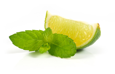 Fresh limes with mint isolated on white photo