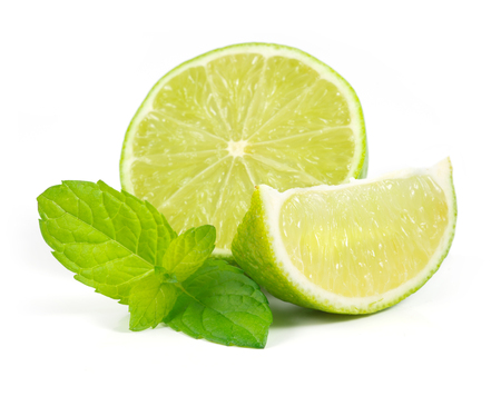 Fresh limes with mint isolated on white