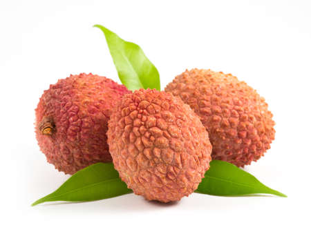 isolated three Lychees with leafs on white