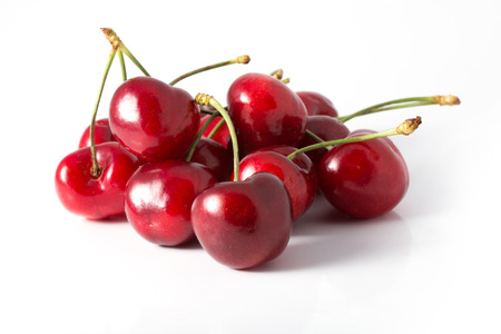 Handful of a red cherry on a white background photo