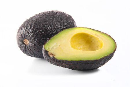 hass: A fresh avocado cut in half Stock Photo