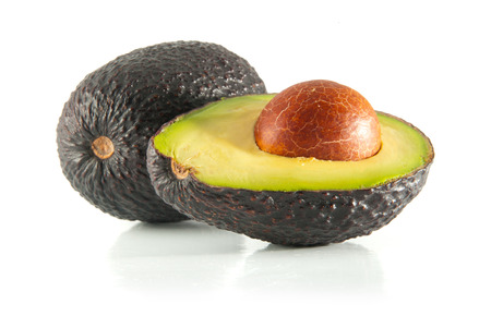 Isolated fresh avocado cut in half with seed Stock Photo
