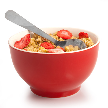 isolated wholegrain muesli breakfast, with lots of dry strawberries photo