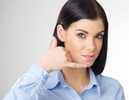 woman making a call me gesture Stock Photo