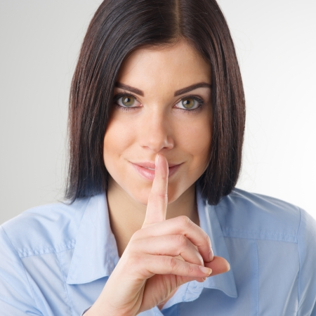 Portrait of woman with finger on lips