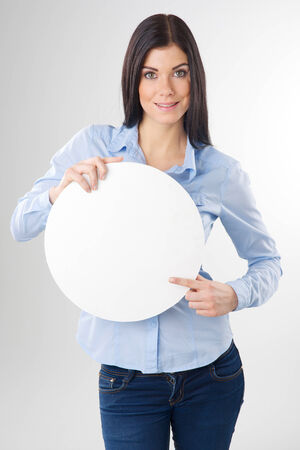 woman pointing to a blank board Stock Photo
