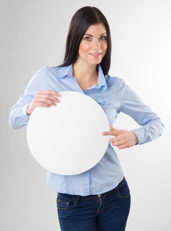 woman pointing to a blank board photo