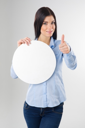 young woman with blank circle board and showing thumb up sign photo