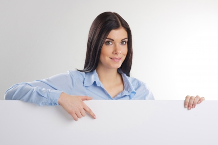 Woman pointing at a blank board