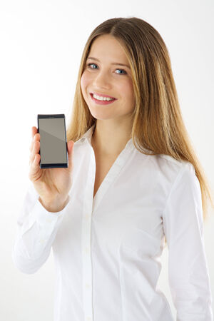 Woman showing empty display of her touch mobile phone photo