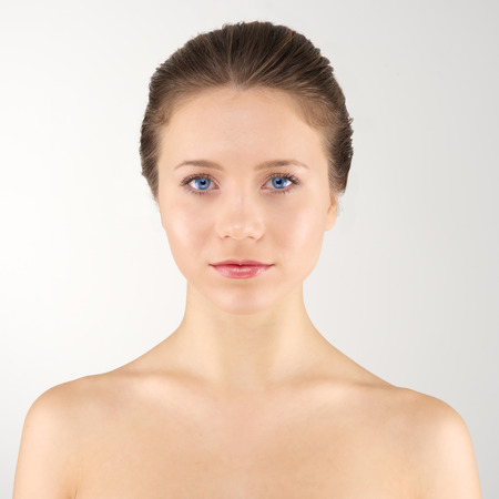 Front portrait young adult woman with clean fresh skin