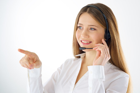 Woman call operator touching imaginary screen with her finger photo