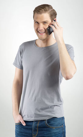 Isolated young attractive man using smart phone