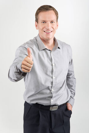 Happy man giving thumbs up sign on white background