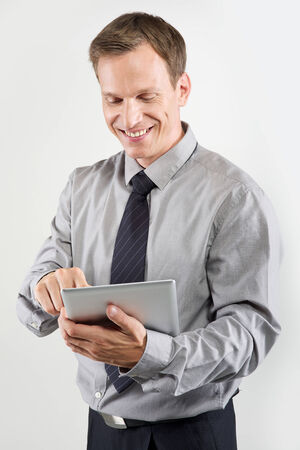 businessman using electronic tablet on white background photo