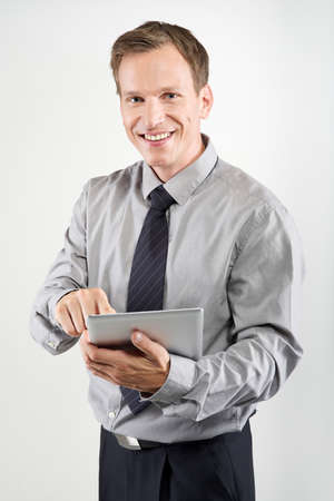 businessman using electronic tablet on white background