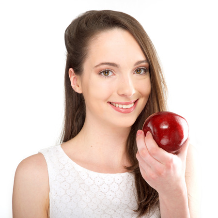 isolated a beautiful girl with apple on white background Stock Photo