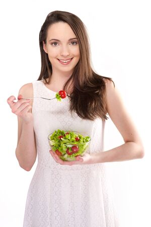 caucasian white: isolated a beautiful girl with salad on white background
