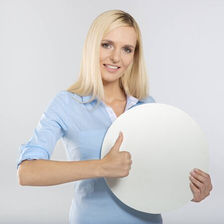 young woman with blank circle board and showing thumb up sign Stok Fotoğraf