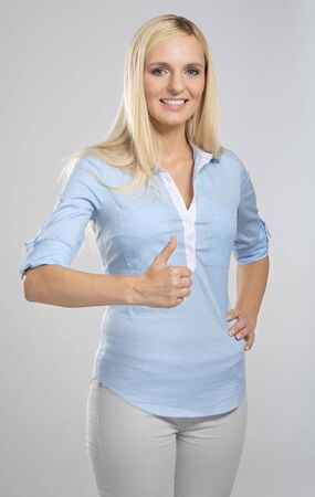 young woman showing thumb up sign