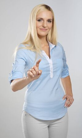 imaginary: Woman touching imaginary screen with her finger