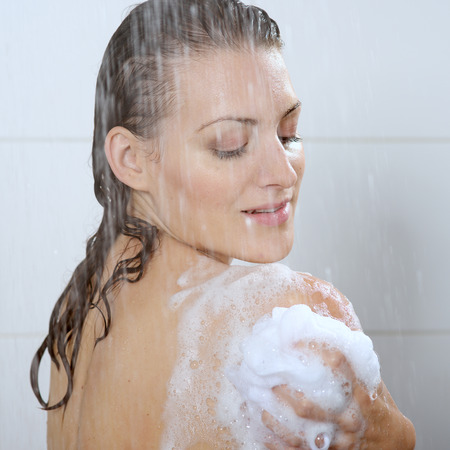 Beautiful woman washing her body shower gel Stok Fotoğraf