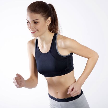 Isolated athletic woman running over a white background Stok Fotoğraf