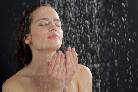 a beautiful woman standing at the shower Stok Fotoğraf