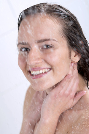a beautiful woman standing at the shower Stock Photo