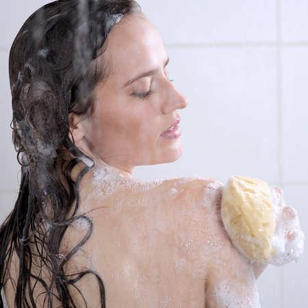 Beautiful woman washing her body shower gel Stock Photo