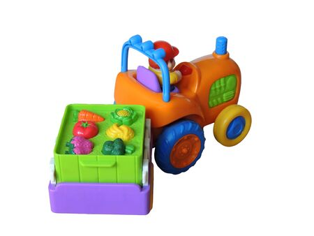 Children s toy Colored small tractor with a truck carrying a load of fruit photo