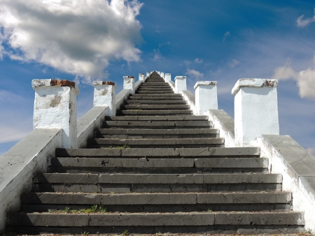 stone stairs on the background of blue sky with clouds photo